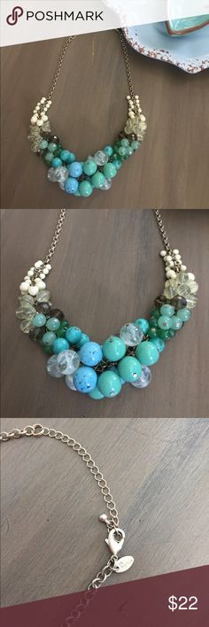 """Lia Sophia Cluster Turquoise statement necklace Gorgeous Lia Sophia statement necklace with clustered beads in Turquoise, gray smoke, clear, Aqua & creams. Wore less than 5 times. This was a hostess exclusive and was pretty pricy, even with the discount I paid over $50. Don't let this one pass you by! Appx 21"""" long Lia Sophia Jewelry Necklaces"""