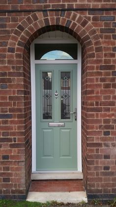 Another popular Ludlow 2 @SolidorLtd Composite Doors in chartwell green.  Trio square green glass design in the door and clear glass in the toplight, black chrome hardware to complete the look.  Installed in West Bridgford, Nottingham. To design your dream door, go to our website http://www.thenottinghamwindowcompany.co.uk for a no obligation free quote #Solidor #Nottingham #Composite #Doubleglazing