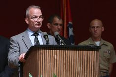 FBI Special Agent Ed Reinhold, left, speaks as Chattanooga Police Chief Fred Fletcher , center, and USMC Captain Ty Balzer, right, listen from behind during a press conference at Tennessee Valley Authority's Missionary Ridge Auditorium on Friday, July 17, 2015 the day after a four Marines were shot and killed. The investigation is being treated as an act of terrorism. Photo by Dan Henry /Times Free Press