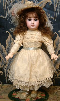 """kathylibratysdolls.com 20"""" ALL ANTIQUE TETE JUMEAU BEBE Bisque socket head on a fully jointed Jumeau body. Lovely deep chocolate brown paperweight eyes. Dimpled chin, original blond human wig"""