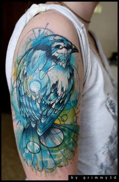 Blue and green sparrow tattoo.