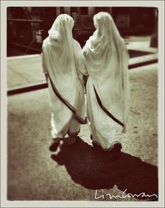 Two nuns crossing 7th Avenue. Photo ©Liza Cowan