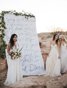 wildest dreams lyrics calligraphy on a backdrop in a desert setting with lush green leaves