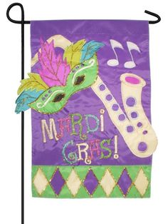 This Mardi Gras Jester will surely liven up your celebration. This awesome flag has four gold, jingling bells attached to each side of the flag plus one bell attached to the end of each of the four lo