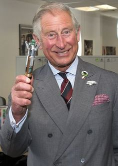 Look how happy Prince Charles is with the sonic screwdriver! I sense a Whovian, shame about the werewolf thing ;)