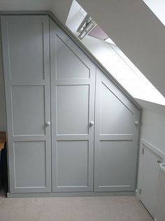 Based in Cornwall we make fitted wardrobes, fitted furniture and fitted kitchens in Cornwall and Devon out of a variety of woods. Slanted Ceiling Bedroom, Attic Bedroom Storage, Bedroom Built In Wardrobe, Attic Master Bedroom, Loft Storage, Attic Wardrobe, Attic Rooms, Bedroom Loft, Loft Conversion Fitted Wardrobes