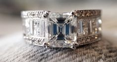 Extremely Beautiful #2CaratAsscherDiamond ring flanked by gorgeous Round Pave, Princess Cut and Baguette Diamonds
