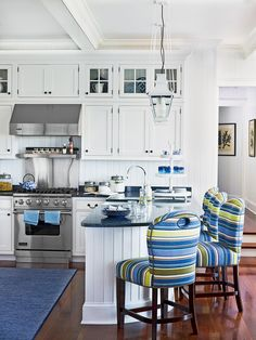 Add a nautical touch to kitchen's in water font cottages and suburban homes alike with comfy bar stools upholstered in a cheery stripe fabric. The look is also dashing on skirted sinks, breakfast nook banquettes, and even dish towels.