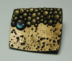 Ponsawan Sila - Pin # 68 - Black polymer clay, Metal paint and Gilders paste.