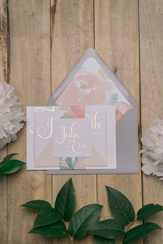 Rose gold foil wedding invitation with grey envelopes and floral patterned liner, beautiful whimsical wedding invitations