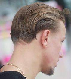 Theneckline hair designtrend just keeps getting bigger. Building on the current hair tattoo trend, this version relocates the design from the sides to the back of the head for an eye-catching rear view. The neckline hair