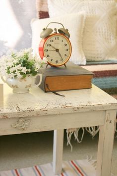 Cottage Time...shabby table...china pot with posies...old book...red alarm clock.