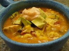 Chicken Enchilada Soup    1 tablespoon olive oil 1 lb. boneless, skinless chicken breast halves 1/2 cup diced onion 1 clove garlic, m...