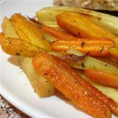 Roasted Sweet Potatoes and Vegetables With Thyme and Maple Syrup Recipe - Fall and winter root vegetables are roasted in the oven with thyme sprigs and a drizzle of maple syrup to make a great side dish to go with any meal.