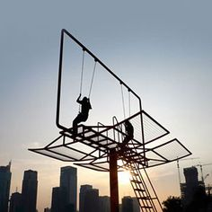 Old billboards become swing sets.