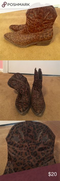 Leopard print ankle cowboy boots size 7 Leopard print brown ankle cowboy boots. By zigi ny. 1 1/4 inch heel, pointed toe, zips up on side. Size 7 Zigi Soho Shoes Ankle Boots & Booties