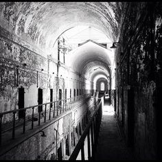 Old prison walkway. Hey, I recognize this hallway from Ghost Hunters!  I think it's Eastern State Penitentiary, but don't quote me on that.