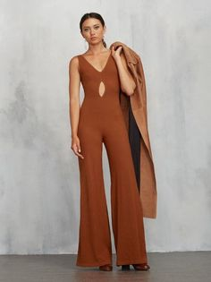 Creep into fall with the perfect catsuit. The Nicosia Jumpsuit is a medium weight ribbed jersey jumpsuit with a V neckline and back, and a little cutout at the waist. Fitted through the bodice and backside then the legs go wide. Also the fabric is super stretchy so you can look hot and be comfortable too.  Made from 88% tencel, 12% spandex.
