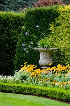 Create a floral centrepiece for your  garden. Try placing a large glazed urn in the center of a planting bed to create a beautiful focal point. Sometimes a huge ginger jar looks just as beautiful as any flowers or shrubs and if it's in a complementary colour – it will look as if it's been there forever.