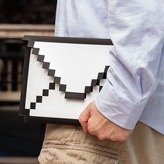 At only $19.99  One of the coolest things we like to do with our iPad is using it to play old 8-Bit games. Why? We don't know, we just do. Heck, we love almost everything if it comes with extra heapings of 8-Bit style. And now we can carry our super high tech iPad in a very retro and low tech looking 8-Bit Tablet Sleeve. #gadget #geek #mail #tablet #cover #ipad