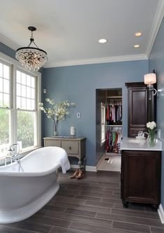 Grey wood floors, blue walls and white trim