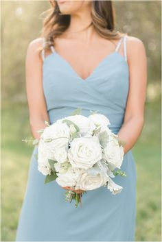 bride in dusty blue dress holds bouquet of all-white roses. Planning a rustic modern wedding in New Jersey? See more inspiration here! | Windows on the Water at Frogbridge wedding photographed by NJ wedding photographer Idalia Photography with florals by Bespoke Florals. #IdaliaPhotography #WindowsOnTheWaterAtFrogbridge Cake Chocolate, Bridesmaids, Bridesmaid Dresses, Wedding Dresses, Jessica Stevens, Floral Wedding, Rustic Wedding, Windows On The Water