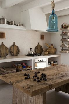 Love this kitchen! A barn board island & turq light = perfect!