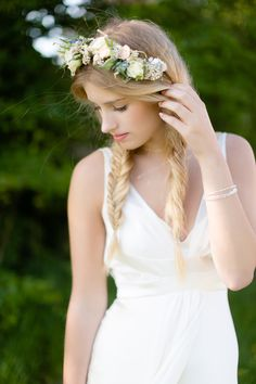 Pretty flower crown with fishtail braids! Let Vênsette's world-class hair and makeup artists craft custom beauty looks for your special day: http://vensette.com/bridal_inquiries