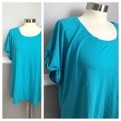 Avenue Tshirt Scoop neck tee shirt with subtle roll on the sleeve. Comfy tee! Avenue size 14/16. Cute to dress up or wear casually! Also selling in coral! 51% cotton 49% modal. First photo on left is not the actual item * just showing for style!  BUNDLES 20% OFF Avenue Tops Tees - Short Sleeve