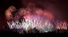Fireworks explode over the Harbour Bridge and the Opera House during New Year's Eve celebrations in Sydney, Australia, Wednesday, Jan. ...