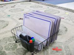 Great idea to use a dish rack to store white boards and markers!