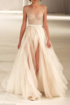 Without the slit it would be magnificent. Love the flow of the material