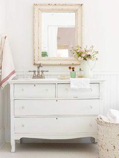Photo Album Website Pretty cottage bathroom with white vintage dresser turned vanity crystal knobs beadboard backsplash and shabby chic mirror