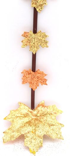 leaf-garland-for-fall - using artificial leaves; glue and glitter - then attach to a garland.  Could we do a variation on this in preschool?  Maybe paint a paper plate and then glue on glitter leaves we have already made for a wreath?