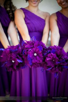 Purple Feather Bridesmaids Bouquet | Shades of purple feathers including schlappen feathers, dyed peacock feathers, and curly goose feathers are embellished with a mix of gold OR silver rhinestone buttons....love the rhinestones