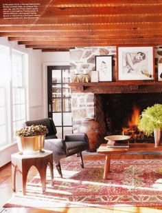 Rustic sitting space w/ large stone fireplace