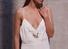 aphrodite necklace // Aphrodite, Goddess of Love and Beauty, has been identified with grace and balance. Feel the beauty and the grace of a swan, Aphrodite's sacred bird! Aphrodite Goddess, Goddess Of Love, Swan, Camisole Top, Bird, Tank Tops, Beauty, Dresses, Women