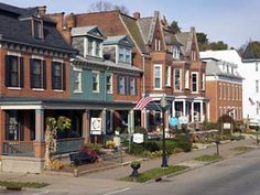 Dubuque, Iowa - courtesy of Parenting.com: love the combination of NY-style townhomes and Southern front porches. I'd love to live in that first one - at least for a weekend - and sit on that porch!