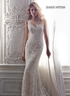 Intricate all over lace adorns this sheath wedding dress with plunging, sleeveless neckline and sexy keyhole back. Breanna by Maggie Sottero.