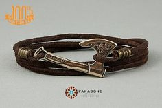 BRACELET WITH AXE The bracelet is made of genuine leather cord and solid bronze axe. Size Axe - 3,6cm x 3cm or 1.42 x 0.79 Genuine leather cord is