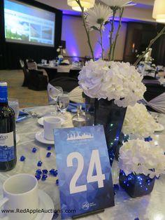 White hydrangeas centerpiece paired with blue