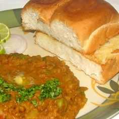 Pav bhaji (Marathi: पाव भाजी) is a fast food dish native to Maharashtra and is popular in most metropolitan areas in India, particularly in Mumbai and the Gujarat region.[1] Pav in Marathi means bread.Pav bhaji consists of bhaji (a potato-based curry) garnished with coriander, chopped onion and a dash of lemon and baked pav.
