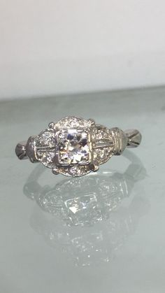 A personal favorite from my Etsy shop https://www.etsy.com/listing/220713777/beautiful-vintage-estate-diamond-ring