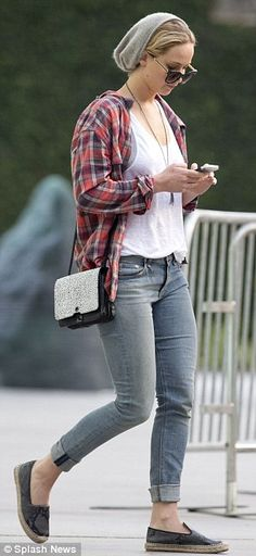 Jennifer Lawrence kept it casual in a grey beanie, dark sunglasses, and a plaid button down as she stared at her phone http://dailym.ai/12kbfsx