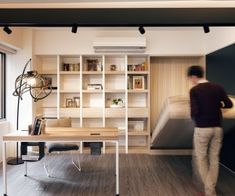 This modern office space quickly becomes a bedroom retreat with a Murphy bed hiding in the wall. It is a smart use of the space as even when...