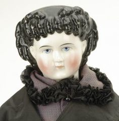 china head doll with unusual hairstyle