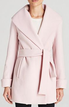 Trina Turk Coat - Ali Wrap   Lambswool/nylon/cashmere; lining polyester   Dry clean   Imported   Large shawl collar, long sleeves, rolled cuffs   Concealed double-breasted snap closure   Tie waist, tw