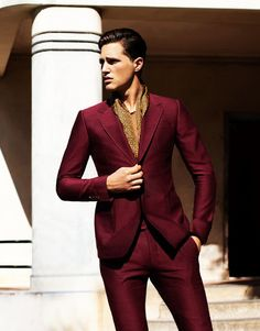 Wine suit by Prada. Brunettes can wear dark reds like this very well but check to see what it looks like when it's on you Before you buy. Pay attention to how it makes you look. Sickly? Handsome? Most importantly: how does it make you feel while wearing it?