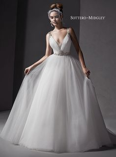 Modern romantic tulle ballgown, with Swarovski crystals adorning the shoulder straps and waistline, Mariam by Sottero and Midgley.