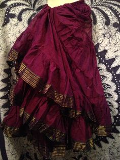 Sari Trim 25 Yard Skirt     25 Yards / 4 Tiers  Measurements   Waist - 32 inches unstretched and 40 stretched   Length - 37 inches